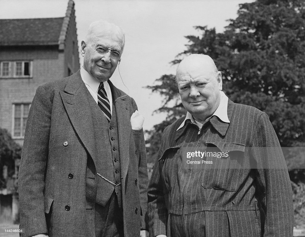 British statesman Winston Churchill (1874 - 1965) welcomes his friend Bernard Baruch (1870 - 1965) to his home at Chartwell in Kent, July 1949. Baruch is an American financier and political consultant. Churchill is wearing his famous 'siren suit', a pinstriped grey wool suit which he wore through the air raids.