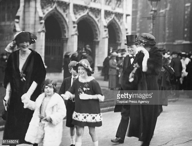 British statesman Winston Churchill with his wife Lady Clementine Churchill among the guests at the wedding of Lord Blandford and Mary Cadogan 17th...