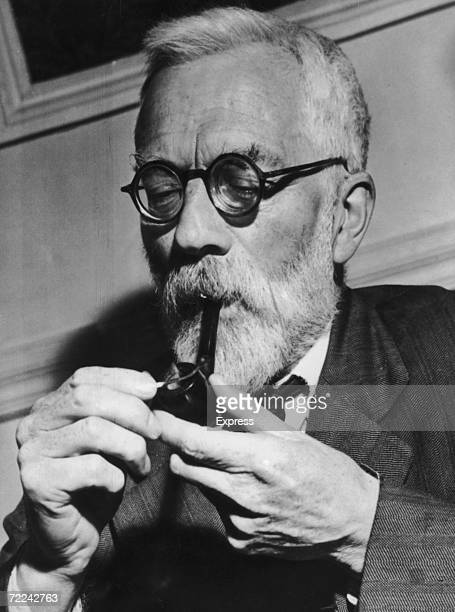 British statistician evolutionary biologist and geneticist Sir Ronald Fisher lights a pipe 5th July 1957 Fisher was sceptical of statistical research...