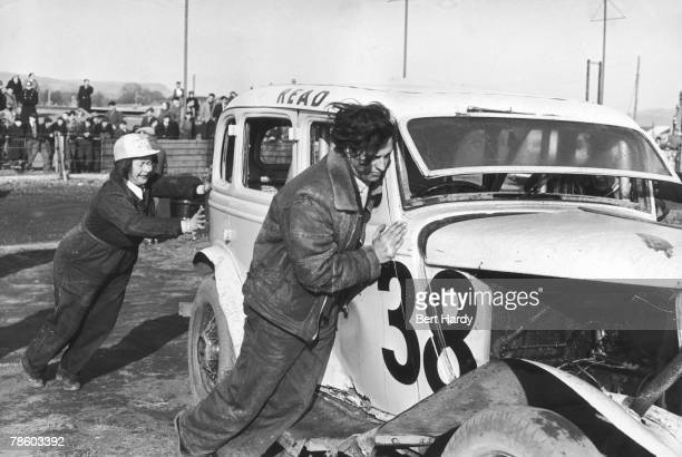 British stock car racing driver Tanya Crouch and her driving partner John Goody at Neath Abbey race track in Wales where they are sponsored by...