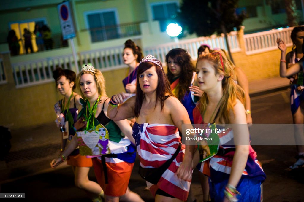 British students in fancy dress walk through the streets during the first night of parties during the SalouFest on April 1, 2012 in Salou, Spain. Saloufest is a sporting tour event where thousands of British university students take part in different sport competitions and join parties during the Easter holidays in the Catalan village of Salou.