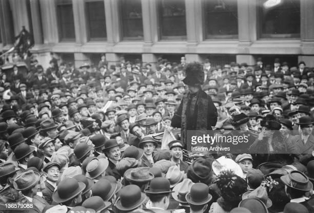 British suffragist leader Mrs Emmeline Pankhurst addresses a crowd on Wall Street New York November 1911