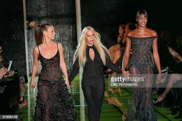 British super model Kate Moss and Naomi Campbell walk with Donatella Versace head of the Gianni Versace fashion house at the end of Versace's 1999...