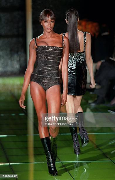 British super model Naomi Campbell wears a shiny black body with boots during the 1999 Spring/Summer haute couture show of Italian fashion house...