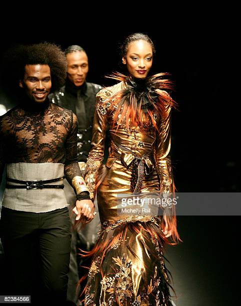 British Supermodel Jourdan Dunn walks the Catwalk wearing a design by David Tlale during the Virgin Mobile Cape Town Fashion Week at the Cape Town...