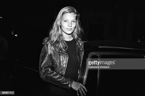 British supermodel Kate Moss arrives at a party for John Waters' film 'Serial Mom' in 1994 in New York City New York
