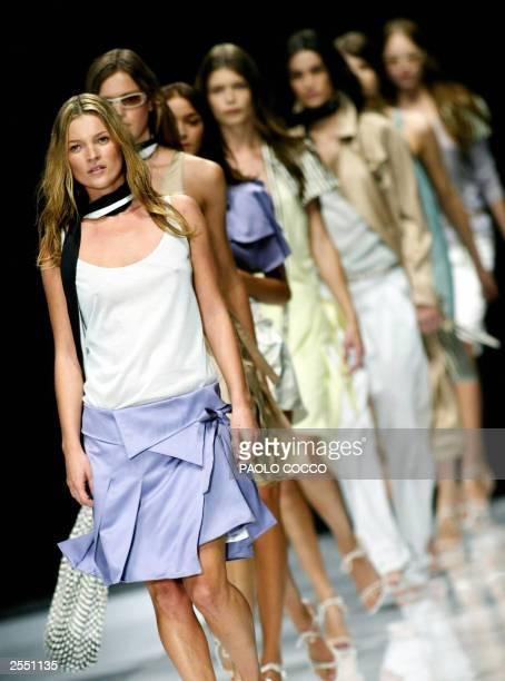 British supermodel Kate Moss leads other models at the end of Burberry Prorsum collection shown during Milan's 2004 Spring/Summer fashion week 30...