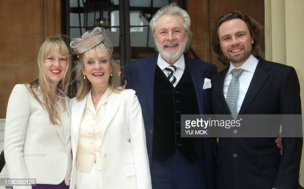 British supermodel Lesley Twiggy Lawson poses with her husband Leigh son Jason and daughter Carly as she arrives at Buckingham Palace before...