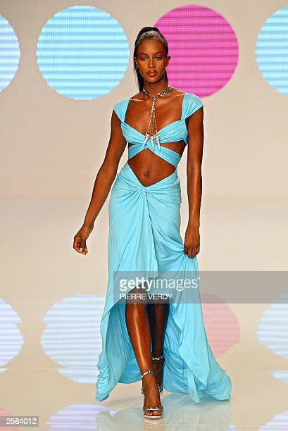 British supermodel Naomi Campbell presents a creation for Valentino 12 October 2003 in Paris during the ready-to-wear Spring/Summer 2004 collections....