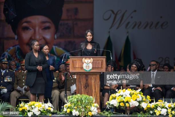 TOPSHOT British supermodel Naomi Campbell speaks during the funeral of antiapartheid icon Winnie MadikizelaMandela at the Orlando Stadium in the...