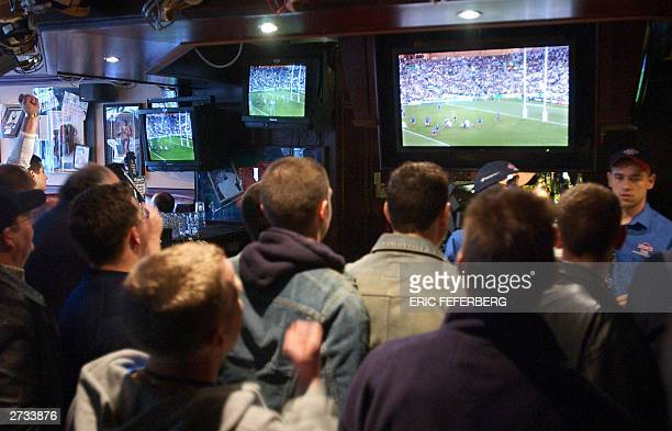 British supporters watch the world championship's rugby match, France vs England, in a sport cafe 16 November 2003 in London. England defeated France...