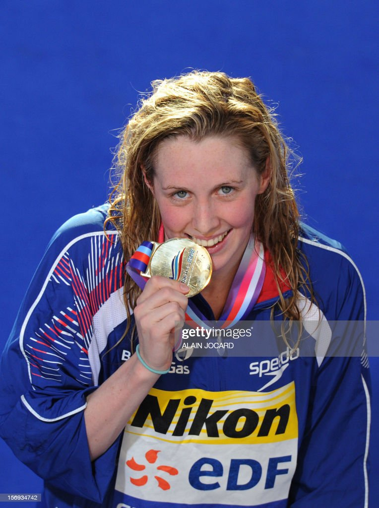 British swimmer Hannah Miley poses with the gold medal after winning the women's short course 400 m individual medley final at the European Swimming Championships on November 25, 2012, in Chartres.