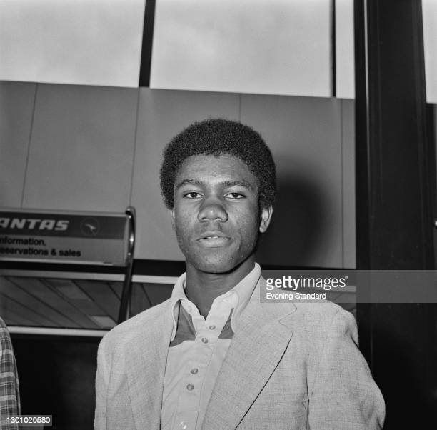 British table tennis player Desmond Douglas of the England youth team at Heathrow Airport in London, en route to Peking for a tour of the People's...