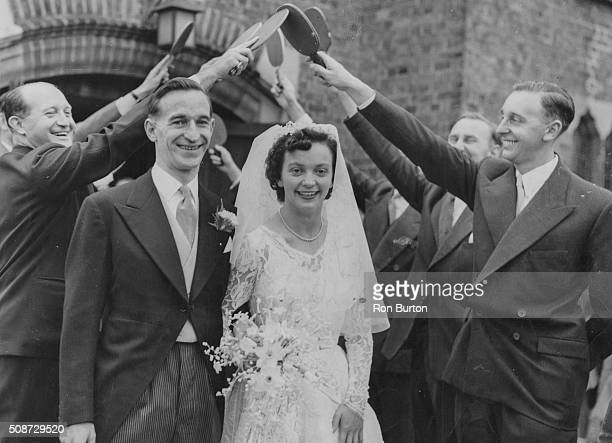 British table tennis player Rosalind Rowe pictured with her husband Dr Jack Corbett leaving St Andrew's Church on their wedding day walking through a...
