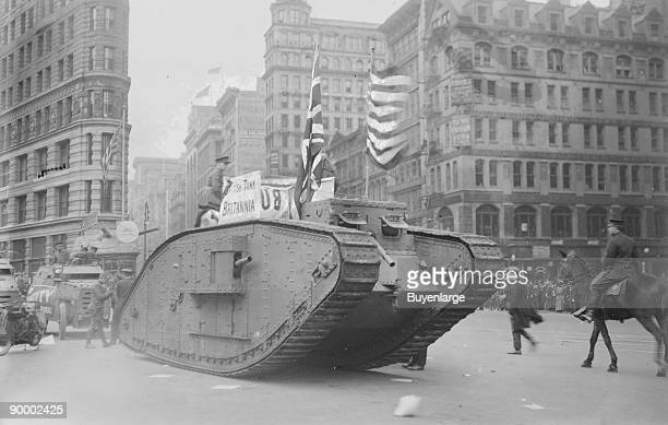 British tank sporting an American American Flag tracks down Fifth Avenue New York in parade with Police Mounted Escort