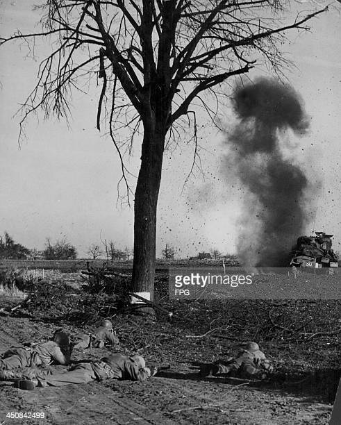 A British tank striking the German lines with US soldiers of the 82nd Airborne Division in the foreground World War Two Germany circa 19391945