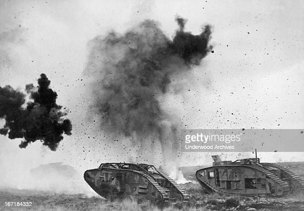 British tanks in action during WWI with German shells bursting around them Europe 1917