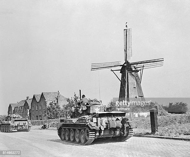 British tanks pass a windmill on their way forward following the liberation of the Dutch town of Eindhoven on September 18th The British armour...