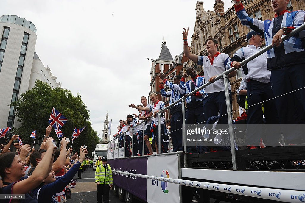 British Team GB members and fans celebrate during the Olympics & Paralympics Team GB London 2012 Victory Parade on September 10, 2012 in London, England.