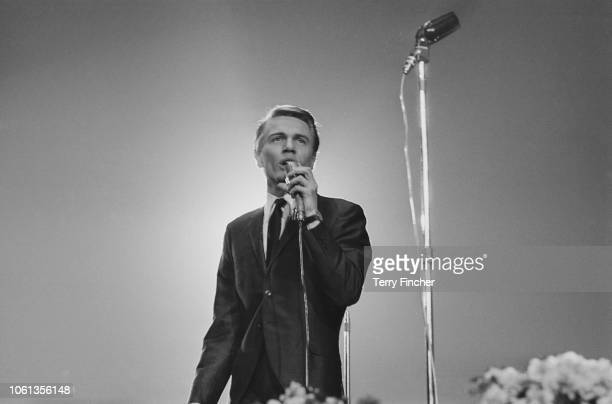 British teen idol singer actor and financial journalist Adam Faith performing at the Daily Express Record Star Show Wembley's Empire Pool London UK...