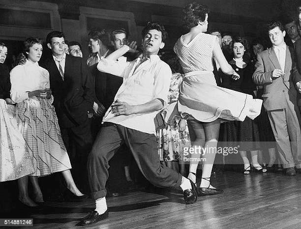 British teenagers dance to Rock and Roll music after the American film Rock Around the Clock arrives in England