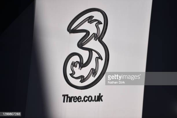 British telecommunications and internet service provider Three UK logo is seen outside ones of its stores on February 1, 2021 in Macclesfield,...