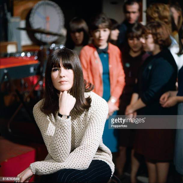 British television broadcaster and presenter Cathy McGowan posed on the set of the television music series 'Ready Steady Go' with teenage audience...
