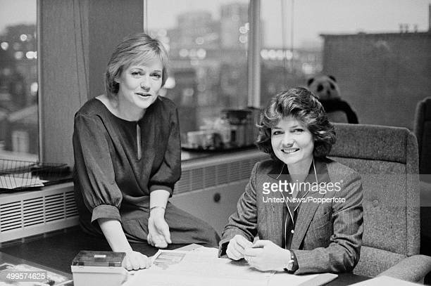 British television broadcasters Carol Barnes and Pamela Armstrong pictured in the offices of ITN in London on 6th December 1984