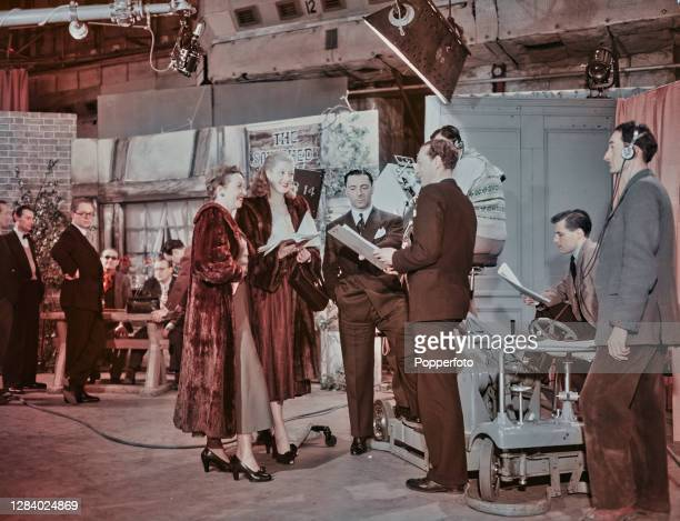 British television executive Ronnie Waldman , Head of Light Entertainment at the BBC, stands 4th from right with actresses Rosalyn Boulter and...