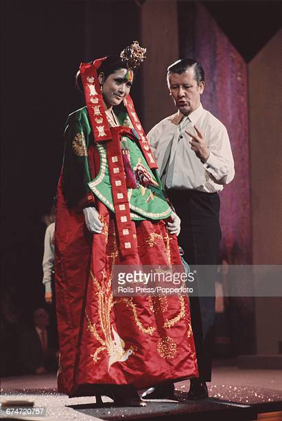 British television host and founder of the Miss World beauty pageant Eric Morley pictured giving floor directions to Miss Korea Kim Seunghee during a...