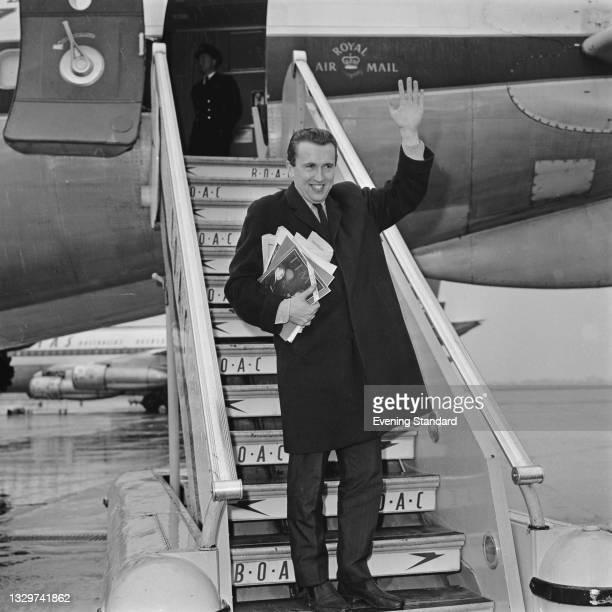 British television host and journalist David Frost at London Airport, UK, 18th November 1964.