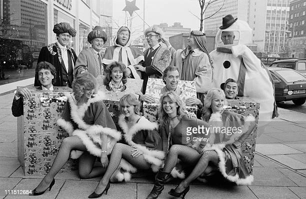 British television personalities pose in Christmas costumes 16th December 1983 Among them are Mike Yarwood Eric Morecambe and Ernie Wise Benny Hill...