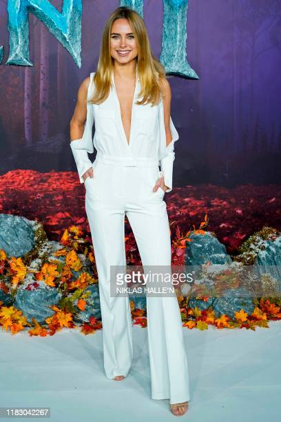British television personality Kimberley Garner poses on the red carpet as she arrives to attend the European premiere of the film Frozen 2 in London...