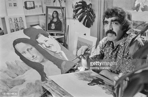 British television presenter and painter Jonathan Routh works on a piece depicting the Mona Lisa and Oliver Hardy in a landscape, UK, 24th October...