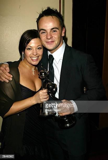 British television presenter Ant McPartlin and girlfriend Lisa smile after winning the 'Special Recognition Award' for the program 'SMTV Live' at the...
