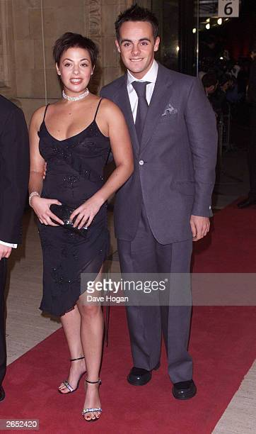 British television presenter Anthony McPartlin and his girlfriend attend the 'Royal Television Awards' at the Royal Albert Hall on October 23 2001 in...