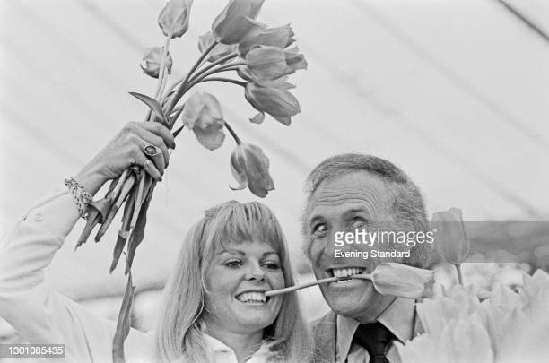 British television presenter Bruce Forsyth with Anthea Redfern, his co-host on BBC game show 'The Generation Game', UK, May 1973. The two were...