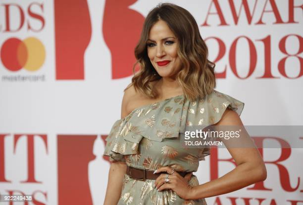 British television presenter Caroline Flack poses on the red carpet on arrival for the BRIT Awards 2018 in London on February 21 2018 / AFP PHOTO /...