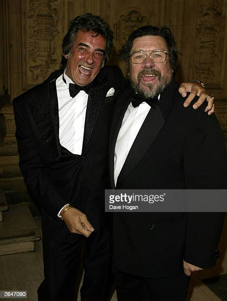 British television presenter David Dickinson and actor Ricky Tomlinson attend the National TV Awards party at the Royal Albert Hall on October 15...