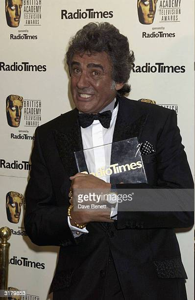 British television presenter David Dickinson attends the Bafta Television Awards held at the London Palladium on April 13 2003 in London