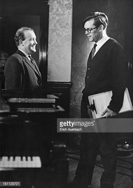 British television presenter Humphrey Burton , the producer of BBC arts programme 'Monitor', chats to Gareth Richards, who appears in the 'Monitor'...