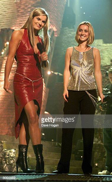 British television presenter Katy Hill introduces British pop star Louise Nurding on stage at the Smash Hits Poll Winners Party held at the London...