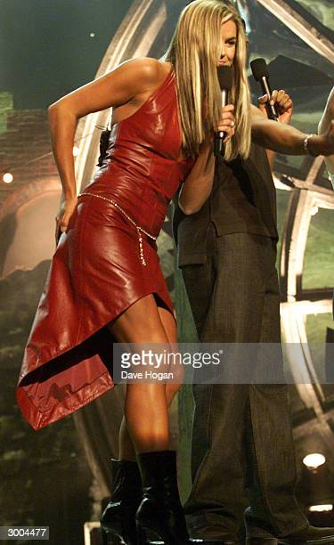 British television presenter Katy Hill performs on stage at the Smash Hits Poll Winners Party held at the London Docklands Arena on December 9 2001...