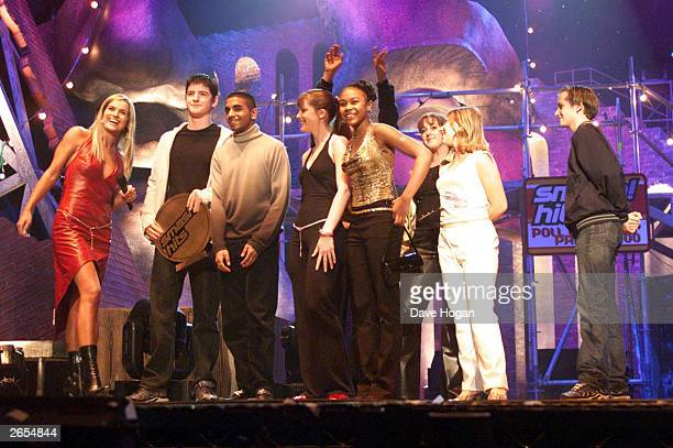 British television presenter Katy Hill presents the award for Best Soap to the cast of the television program Eastenders on stage at the Smash Hits...