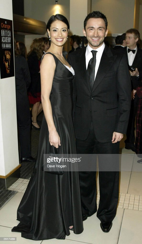 British television presenter Melanie Sykes and her husband attend the 2003 Orange British Academy Film Awards 'The BAFTAS' Held At The Odeon, Leicester Square on February 23, 2003 in London.