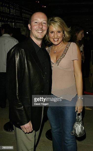 """British television presenter Nicki Chapman and her husband attend the pop group Westlife's """"Unbreakable"""" album launch at the Zuma Restaurant on..."""