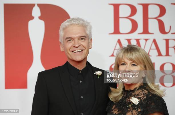 British television presenter Phillip Schofield and his wife Stefanie Lowe pose on the red carpet on arrival for the BRIT Awards 2018 in London on...