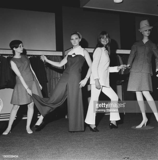 British television presenter Samantha Juste trying on fashions in a store, UK, 4th October 1966.