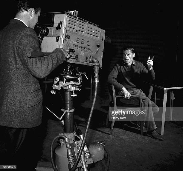 British television presenter Steven Skoyles during a recording of a BBC film for deaf children Mr Skoyles uses sign language when presenting the film...