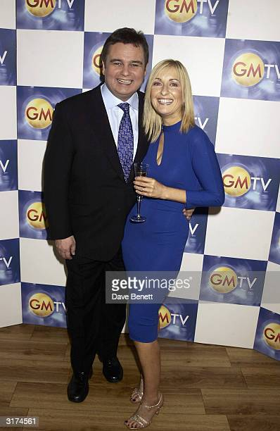 British television presenters Eamonn Holmes and Fiona Phillips arrive at the 10th anniversary party for the television programme GMTV held at Madame...